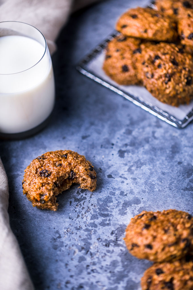 Oatmeal raisin protein cookies with a glass of milk