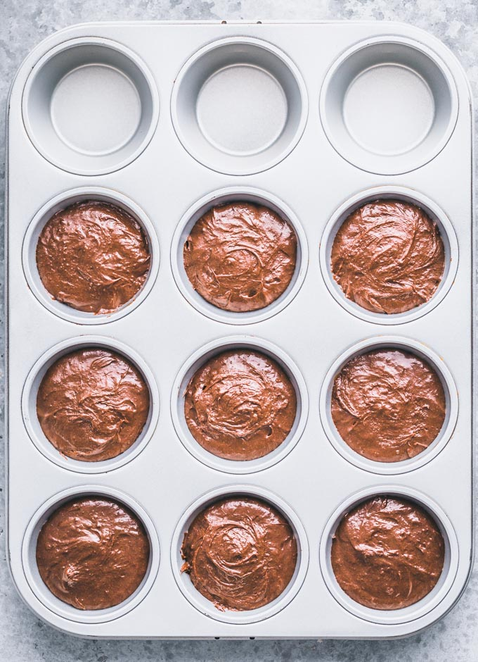 Brownie batter in a muffin pan