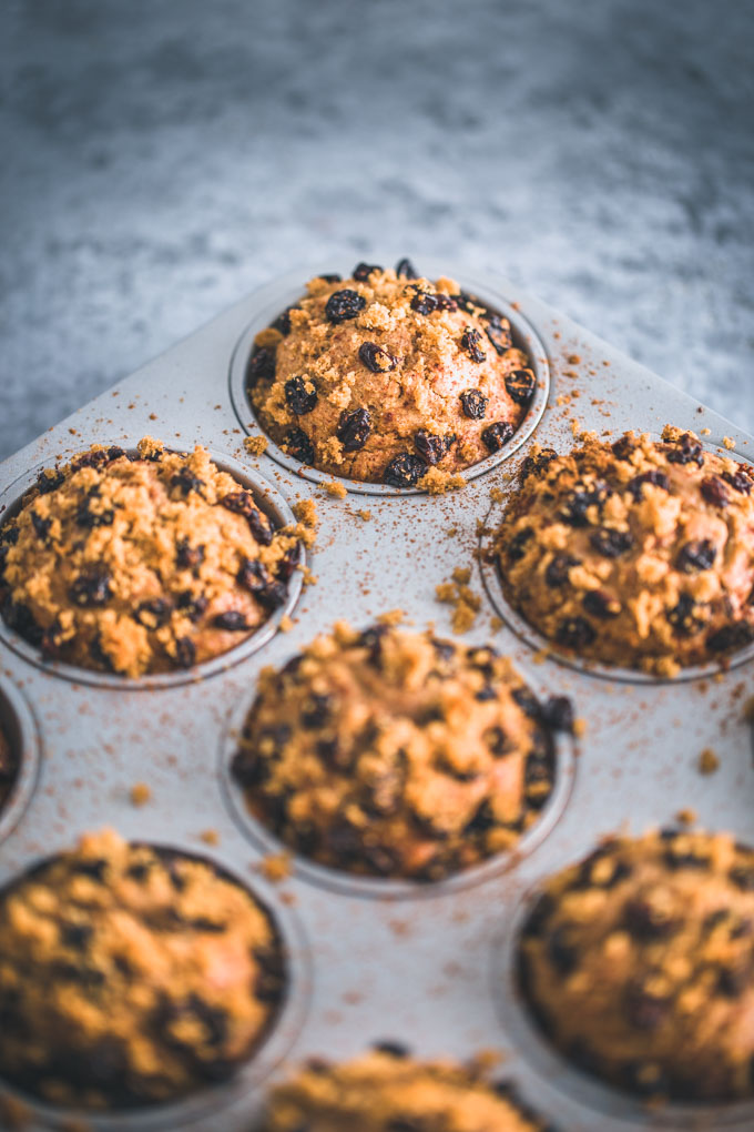 Oatmeal raisin protein muffins in a muffin tin