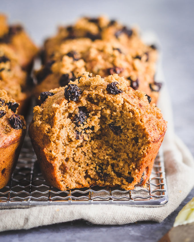 Oatmeal raisin protein muffins on a cooling rack