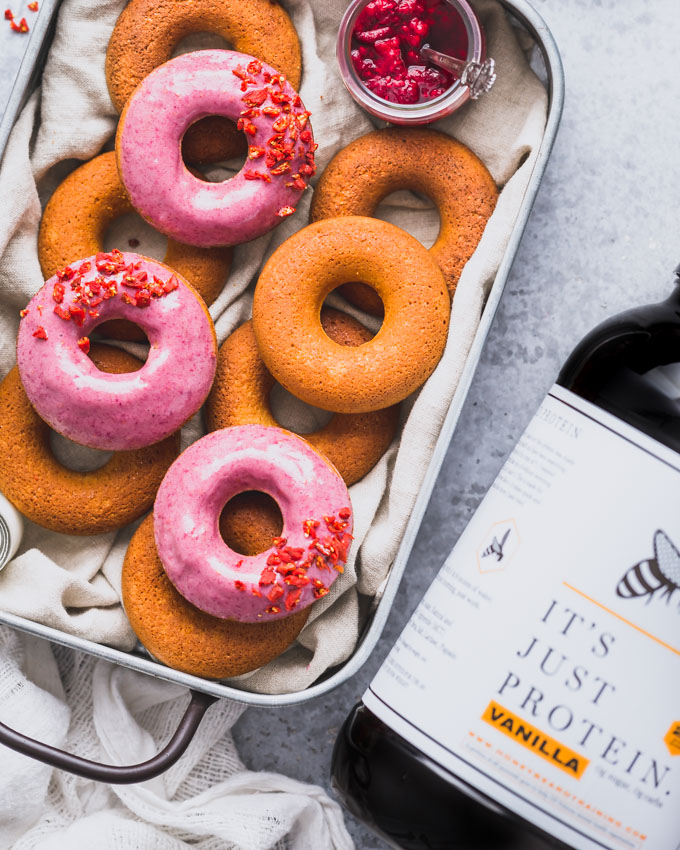 Vanilla Protein Donuts in a metal tray and a whey protein tub