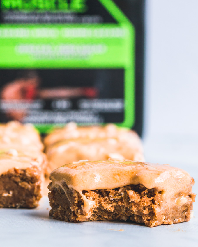Caramel oatmeal protein bars with a bite taken