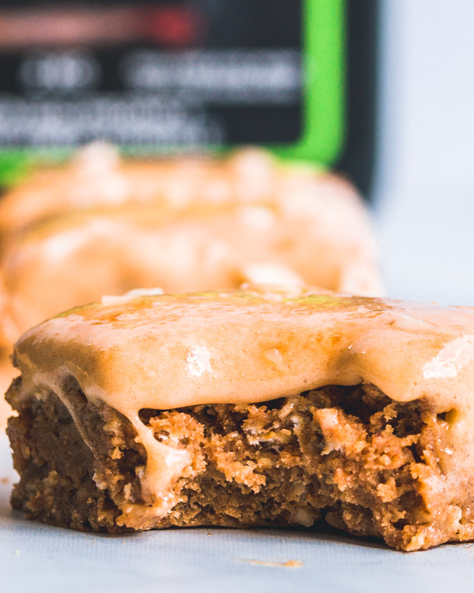 Caramel oatmeal protein bars with a bite taken. Closeup shot