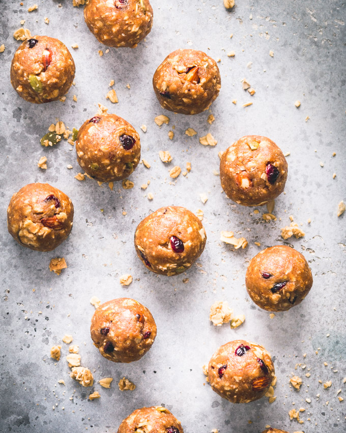 Cranberry Almond Granola Protein Balls on a blue background