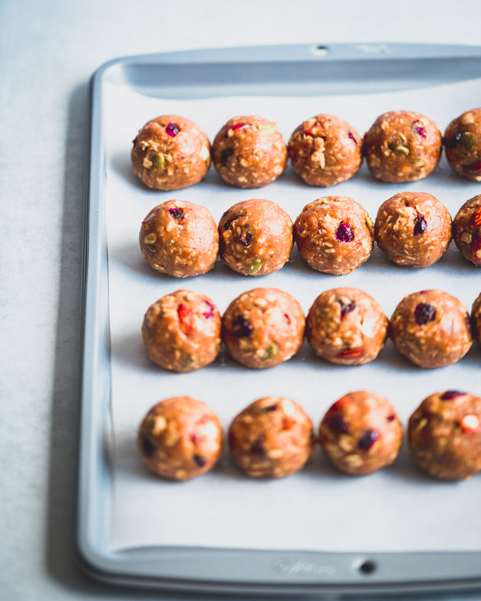 Cranberry Almond Granola Protein Balls on a baking pan