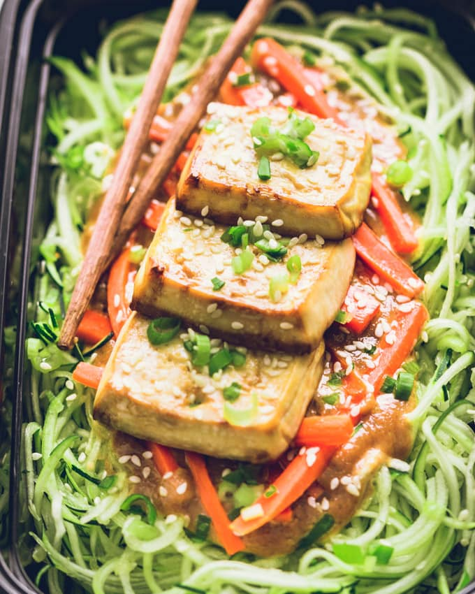 One Vegan Peanut Butter Tofu on Zoodles serving in a meal prep container