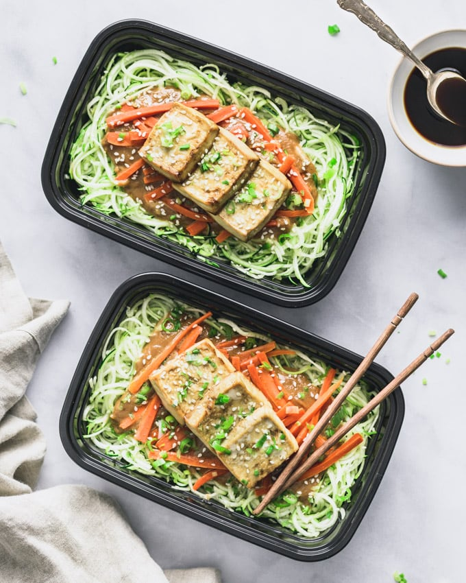 Two Vegan Peanut Butter Tofu on Zoodles servings in meal prep containers