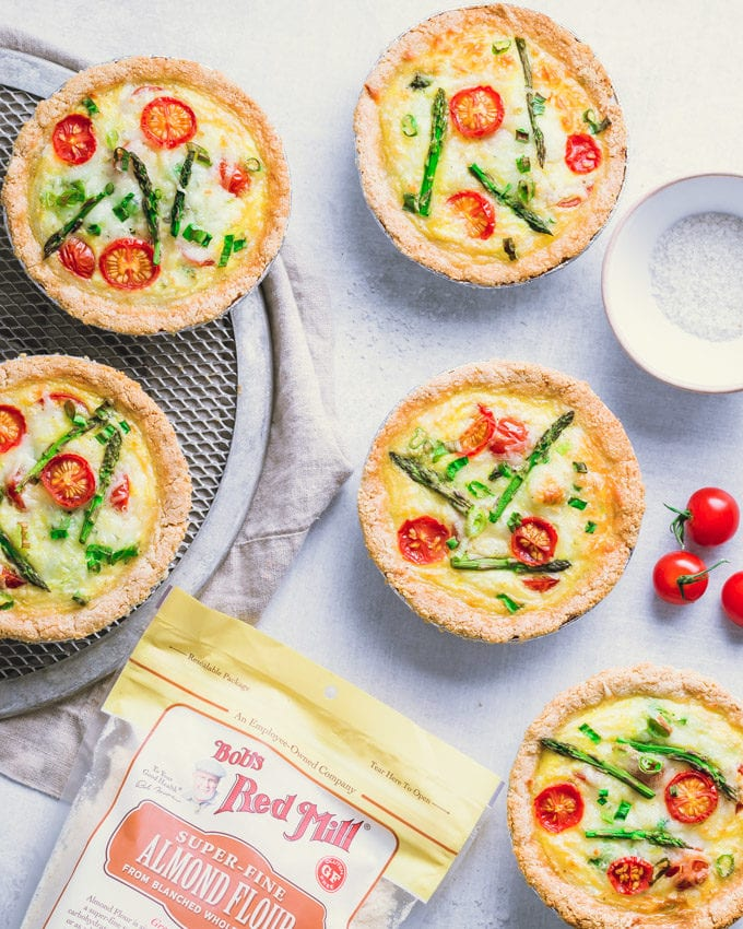 Tomato asparagus small quiches on a gray surface