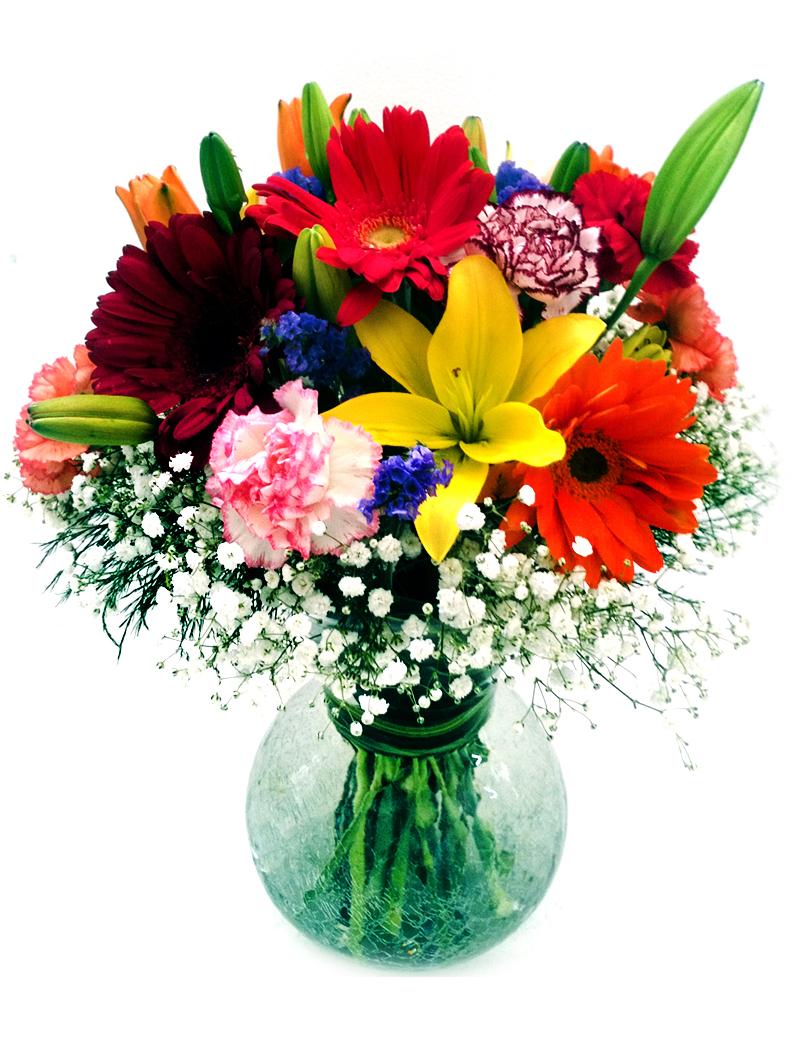Flores con jarrón de cristal