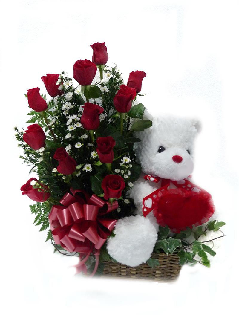 Arreglo de rosas con peluche
