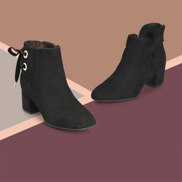 Black suede Lloy and Moero booties on geometeric background
