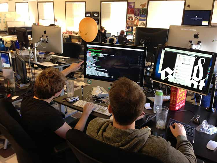 Two developers collaborting over some code.