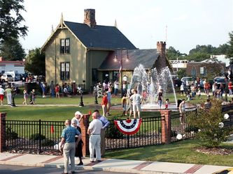 Railroad house fountain with crowd small