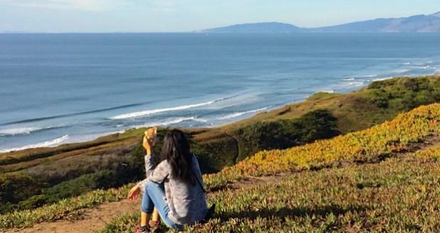 Solo Female Traveler on Cliff