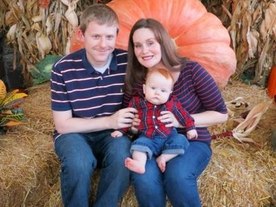 Troy Goode, with his wife and child