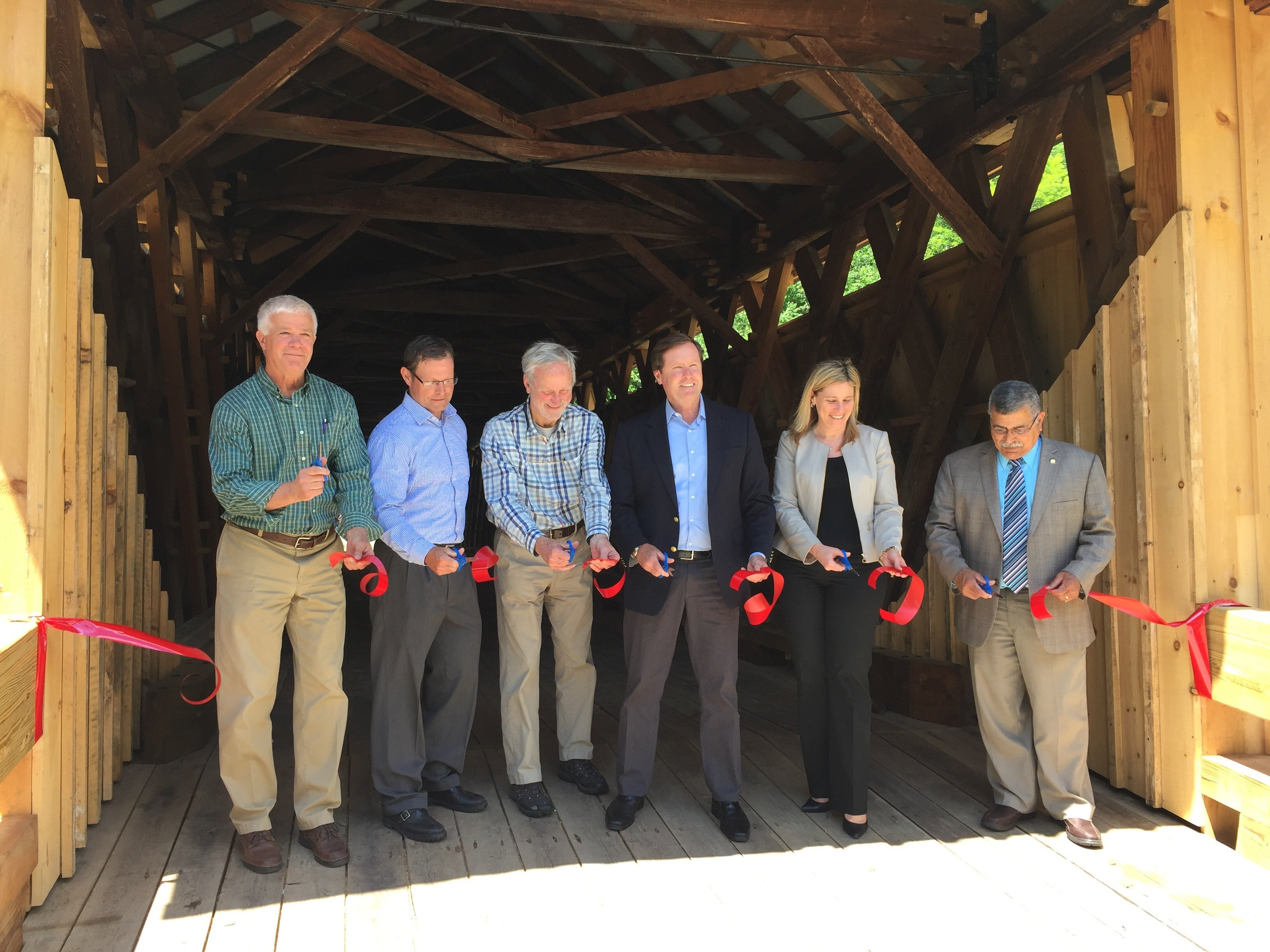 Ribbon Cutting: left to right: Joe Martens, (OSI Senior Fellow); Jack Williams (DOT Regional Director); John Adams, Matt Driscoll (DOT Commissioner); Kelly Turturro (DEC Regional Director) and Luis Alvarez (Chairman, Sullivan County Legislature