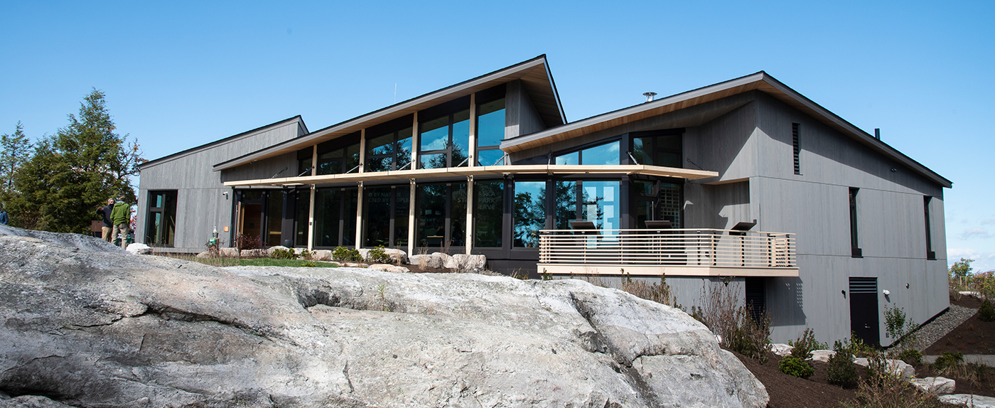 The Lake Minnewaska Visitor Center features elements that minimize the building's environmental impact to reduce disruption to wildlife, protect water quality, and harness renewable energy.