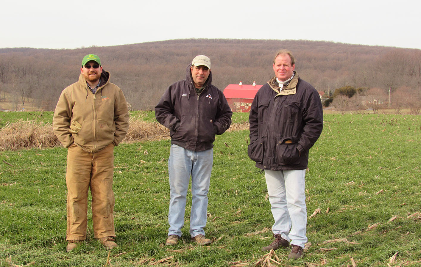 Matt Beam, his father Bill Beam and Jack Stefferud of NLT at Yoder Farm