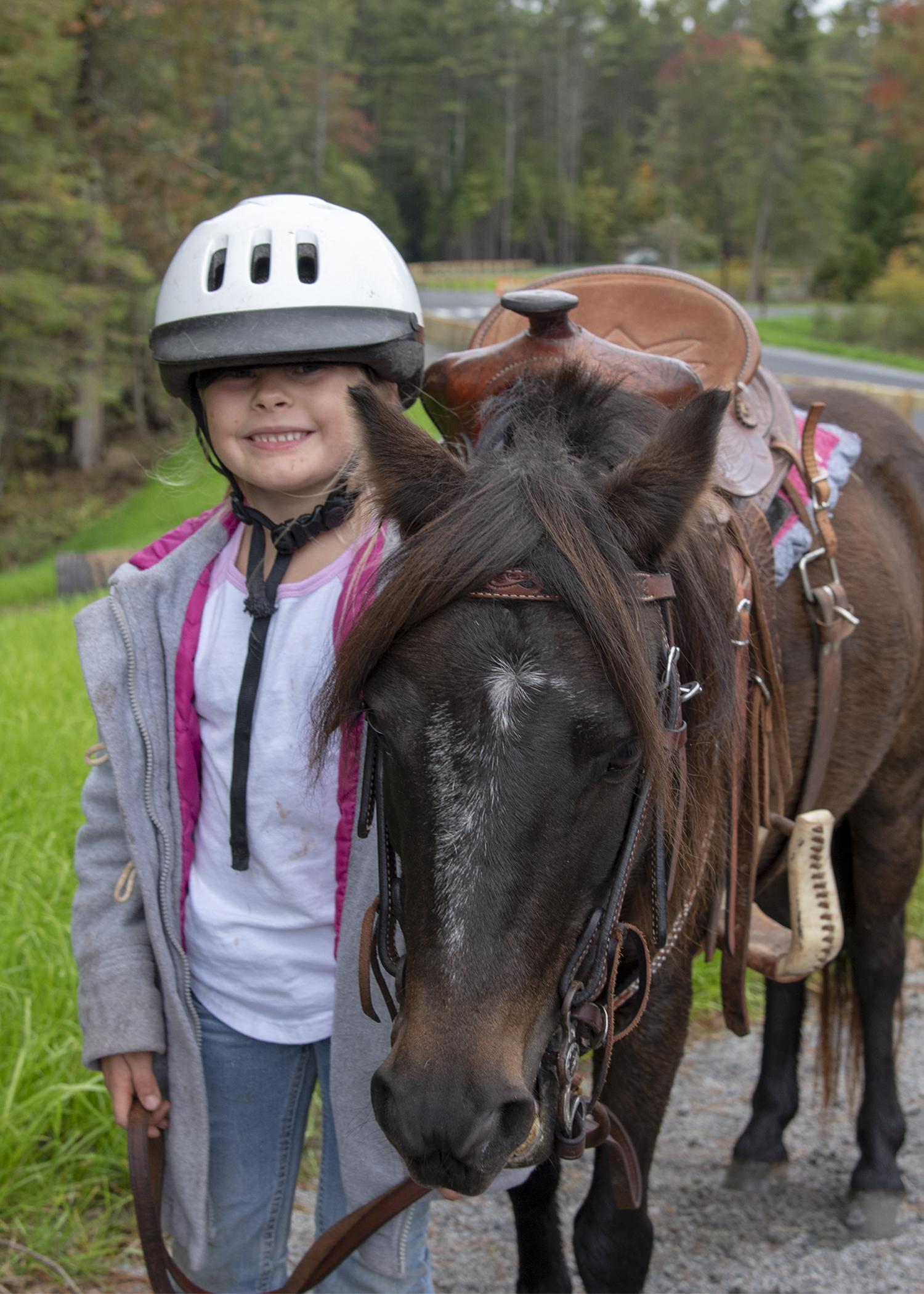 Young equestrian enjoying the new gateway.