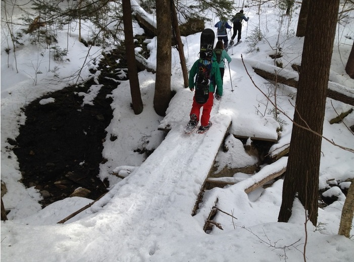 Snowboarders enjoy Ascutney Mountain Community Forest in Vermont, created on the lands of a former ski resort.