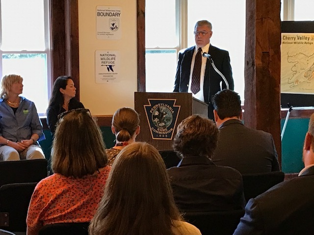 OSI's Bill Rawlyk speaks at a ceremony celebrating conservation of the property.