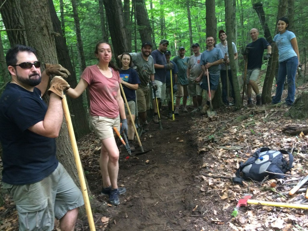 Community volunteers help rebuild trails within the Ascutney Mountain Community Forest, site of a former ski resort.