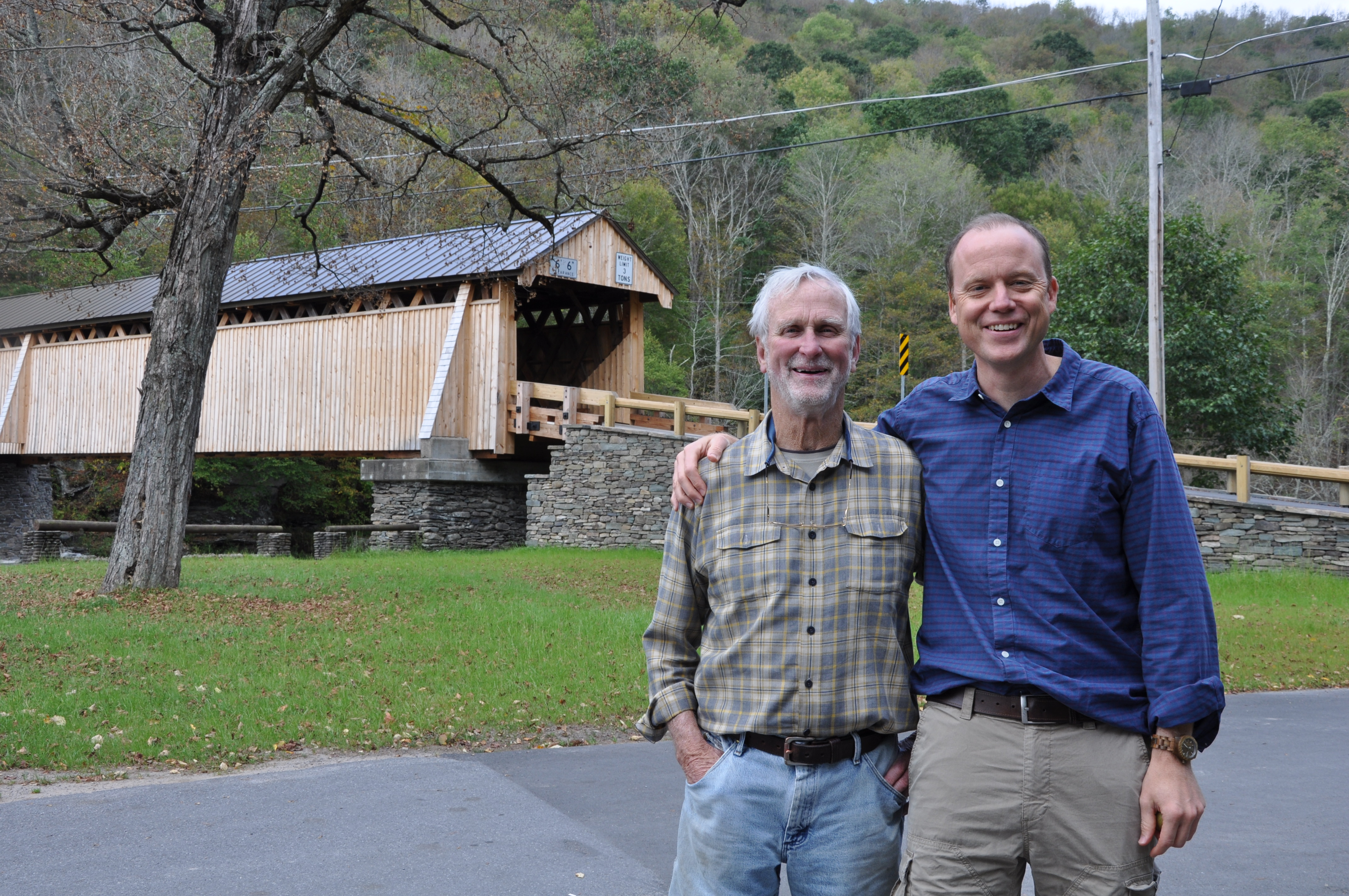 OSI founding Chairman John Adams (left) and Terrence Nolan, Senior Vice President Conservation Transactions, in front of the bridge.