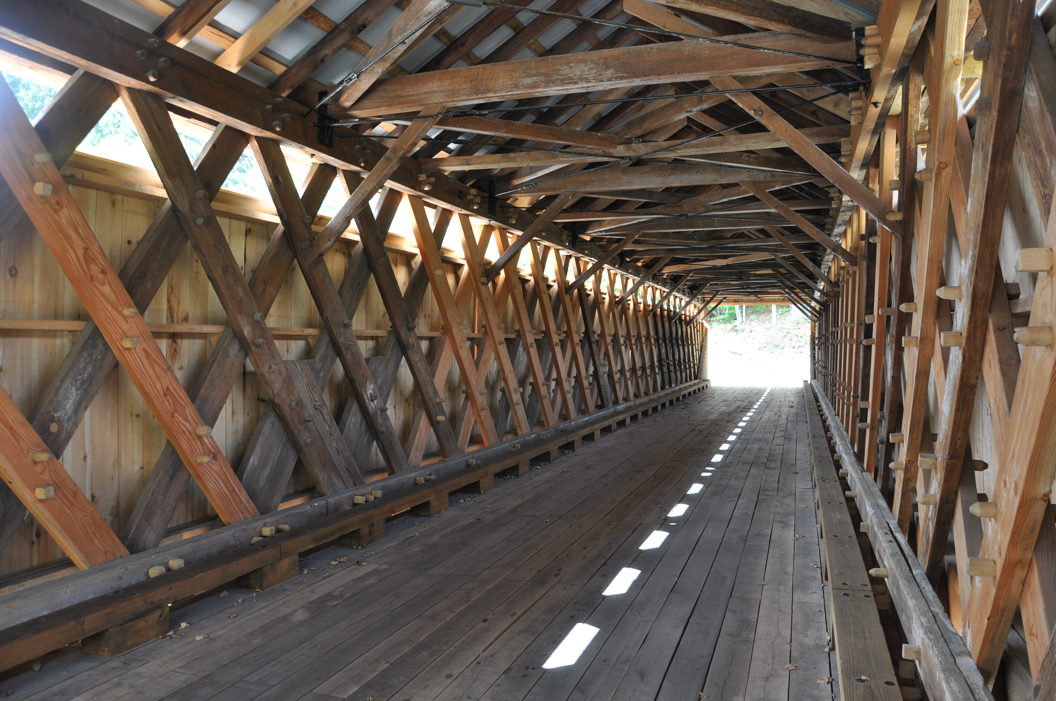 Inside of the Beaverkill Covered Bridge highlighting the careful restoration of the historic structure — including reproduction of its wooden peg engineering.