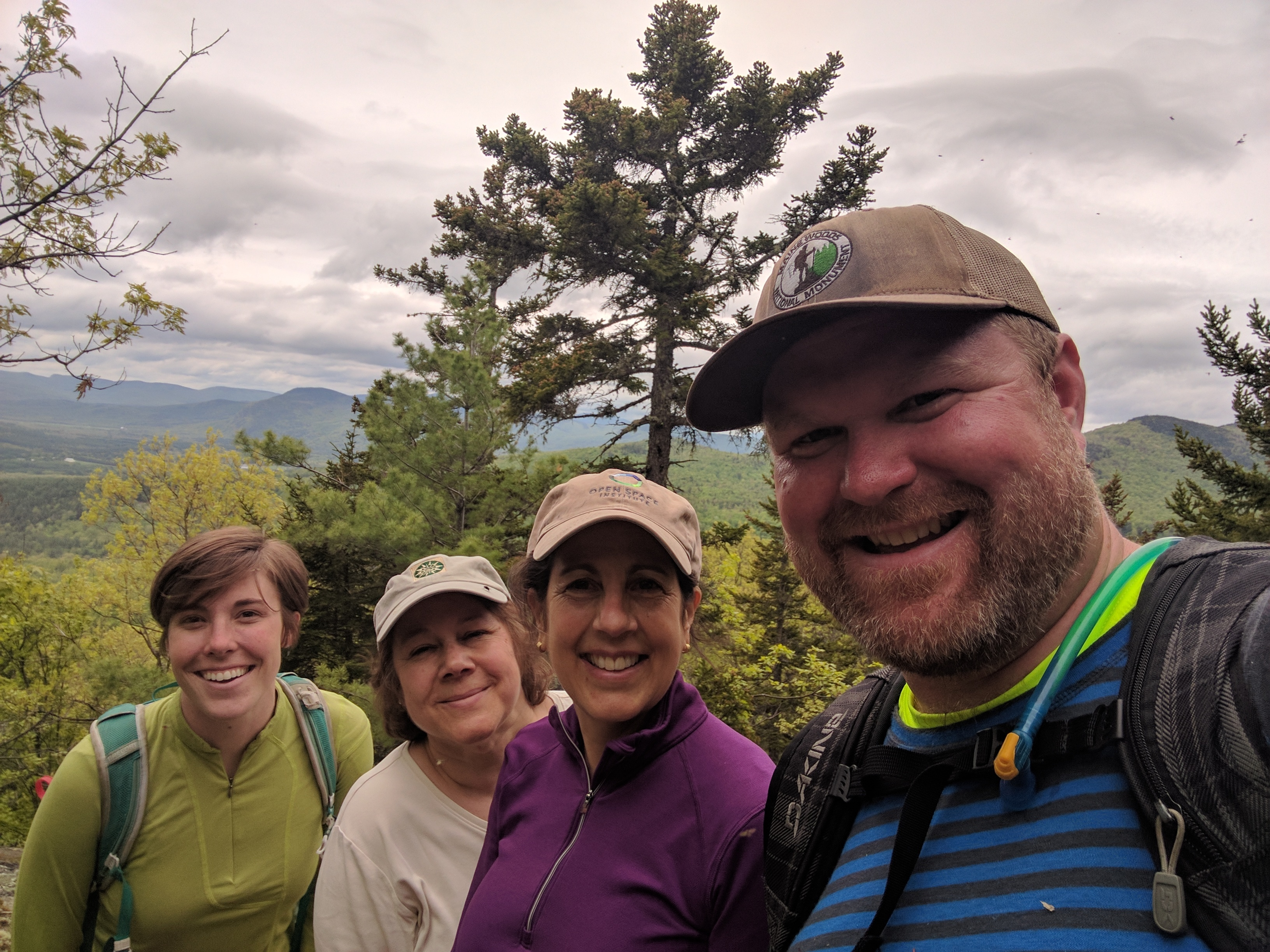 OSI's Jen Melville (second from right) with conservation partners at Bethel Community Forest.