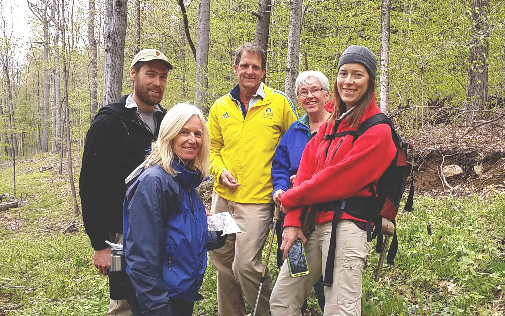 Enjoying a hike on newly conserved land, from left: Nancy Everhart, of Vermont Housing & Conservation Board; Dan Healey, Geordie Heller, and Pat Shields from Putney Mountain Association, and Allaire Diamond from Vermont Land Trust.