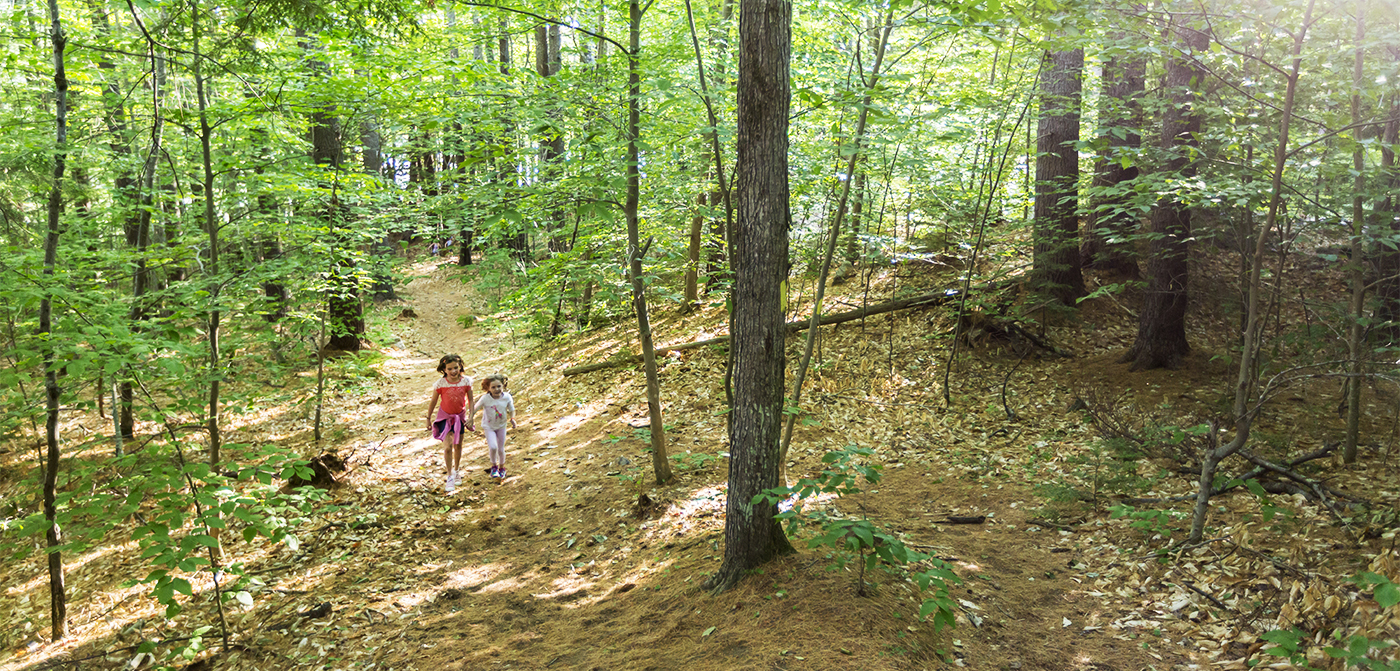 Two young residents of Meredith, NH, visit the town's newly-protected addition to Page Pond Community Forest.