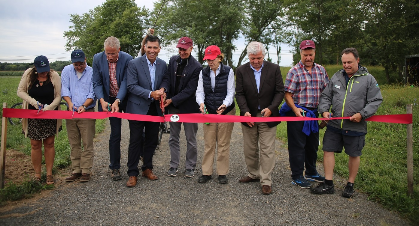 Ribbon Cutting. The Open Space Institute (OSI) today announced the official opening of the River-to-Ridge Trail in New Paltz, New York. The completed section of trail runs along the Wallkill River from the Carmine Liberta Bridge to Butterville Road.