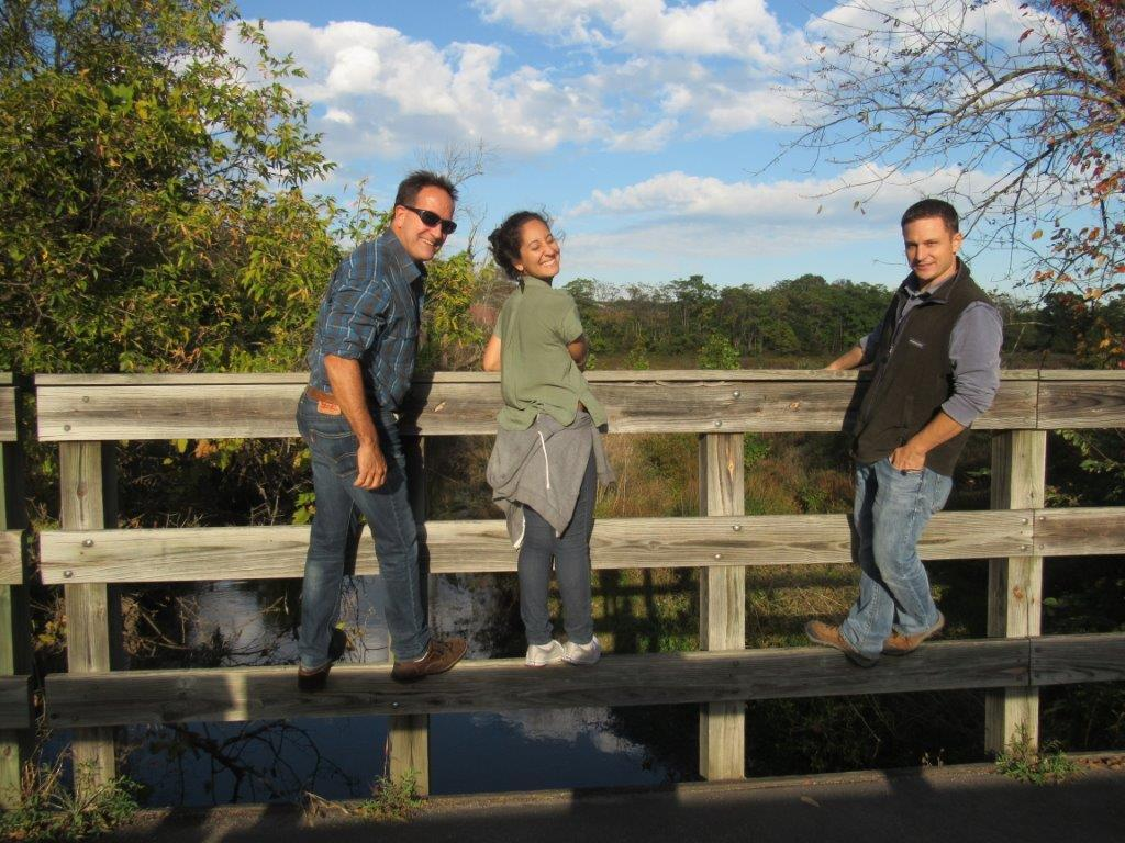 Peter Howell, Dyaami, Nat Sadjak on a bridge over the Peterskill River.