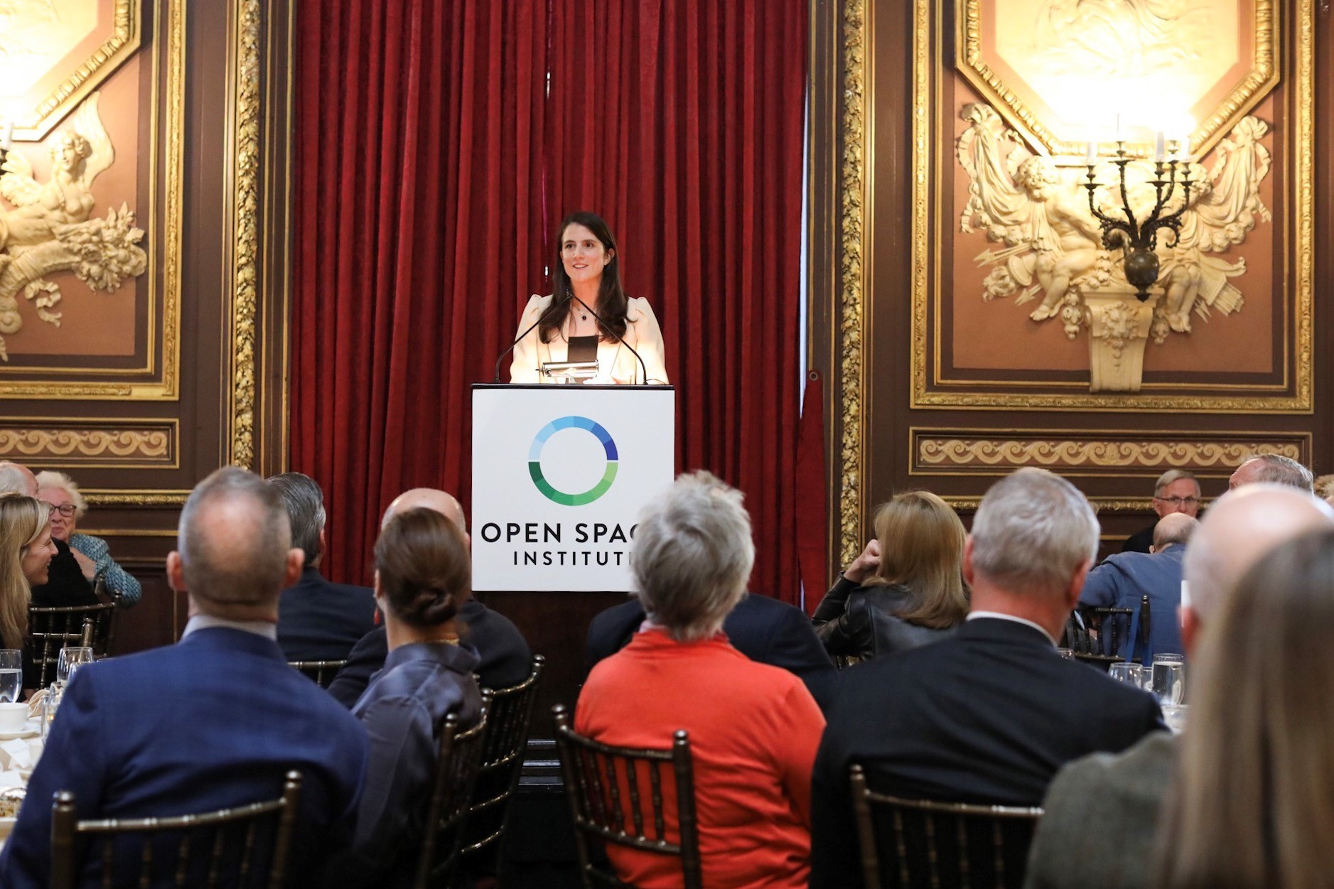 """""""Inconspicuous Consumption"""" author and former New York Times Science journalist Tatiana Schlossberg delivers the keynote address at OSI's annual Luncheon."""