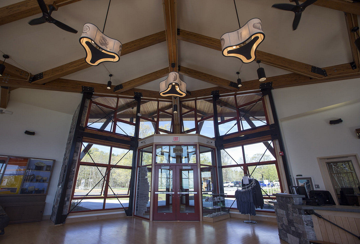 Entry way of Thacher Park Center, featuring the fossil pendant lamps.