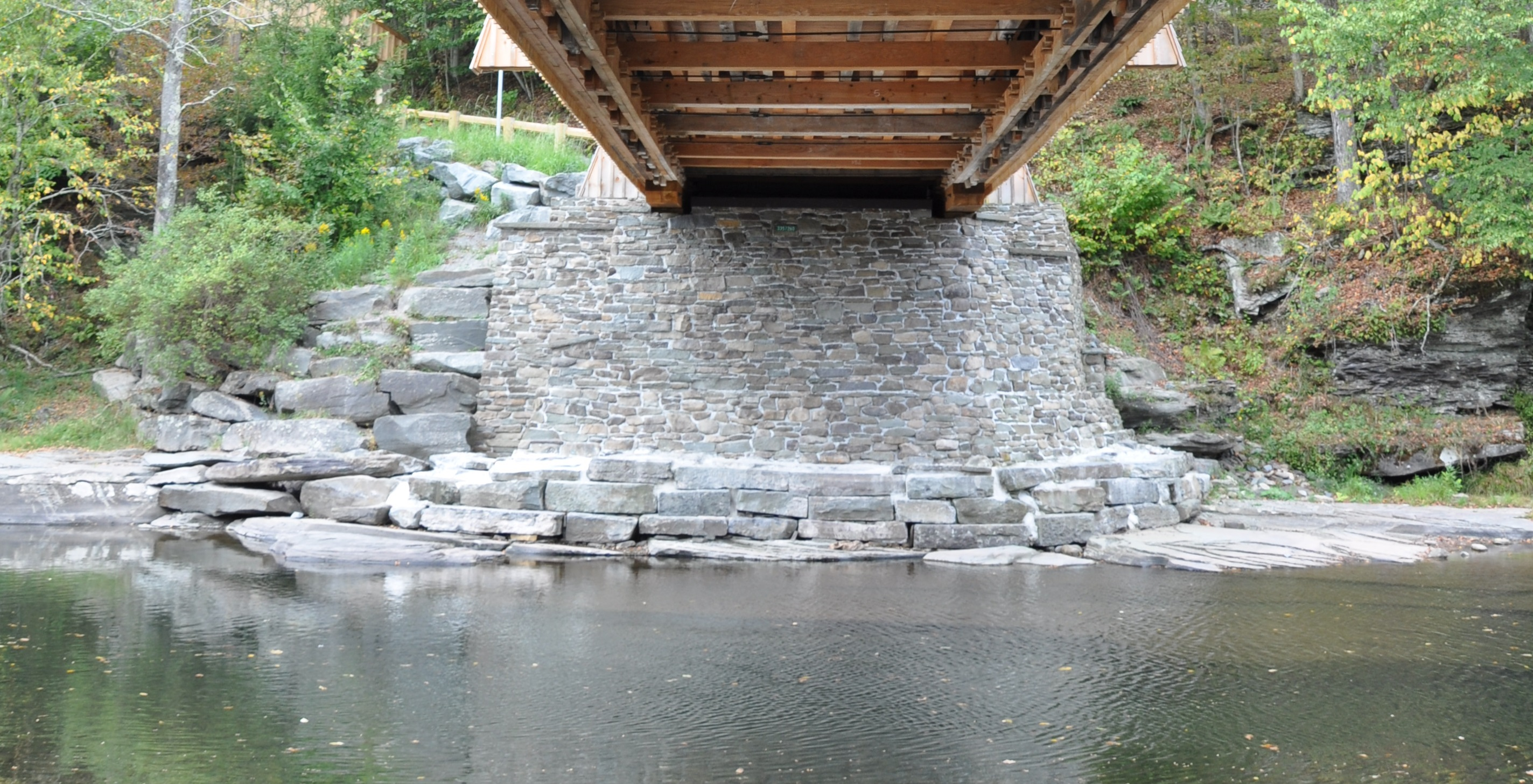 Stone-clad ramps and piers are part of the restoration of the historic Beaverkill Covered Bridge.