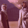 Michael Burnham and Philippa Georgiou stand in the desert; the photo has been edited to look pink
