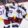 A picture of Werenski, Duclair, and Anderson celebrating a power play goal.