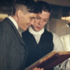 Tommy and John Shelby reading a book and smiling