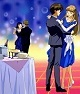 Relena and Heero dancing, bubbly on ice on a table with glasses.