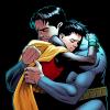 Bruce Wayne hugging Damian Wayne