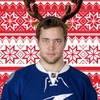 Victor Hedman wearing antlers in front of a red and white snowflake-theme background