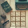 Bingo card on a desk with paper and typewriter