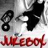 "Music listener sprawled on bed, vinyl record beside, text ""JUKEBOX"""