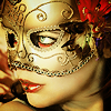 woman's face in gold half-mask