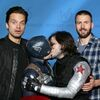Sebastian Stan and Chris Evans pose with fans dressed as Steve & Bucky, who are KISSING!