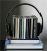 pod together icon - headphones surrounding a pile of CD cases sitting on a pile of books