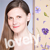 "Picture of Louise Brealey on left half, framed with floral panel of purple flowers on khaki yellow background with word ""lovely"" in faded white text diagonally across lower left corner and middle of icon"