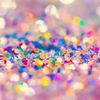 glitter confetti on a pink background