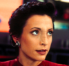 A determined young woman (Kira Nerys, ds9) looking at someone offscreen